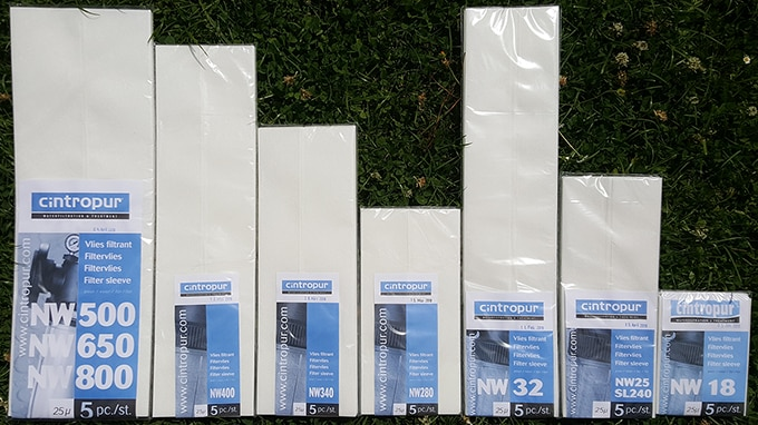 Photo grouping the filter sleeves designed for the seven models of Cintropur water filters. Each pouch shown here contains five 25 µ filter sleeves